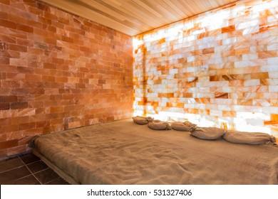 Spa or sauna with himalayan pink salt, room interior.
