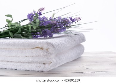 Spa, service hotel and resort concept. White towels and fresh flowers.