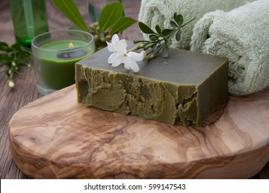 Spa set - assorted handmade organic soap, fresh Jasmine flowers, and bottle of organic oil for spa treatment.
