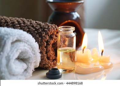 Spa set with essential oils, towel and aromatic candles