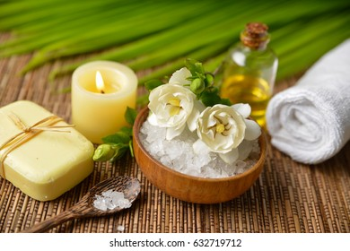 spa set on mat with palm, salt in bowl