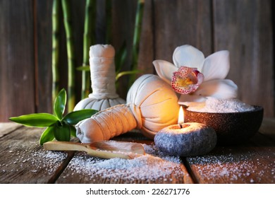 Spa set on wooden surface on wooden wall background