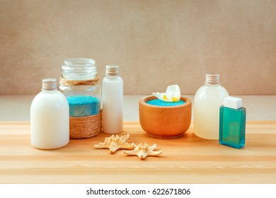 Spa set on wooden table on neutral background.