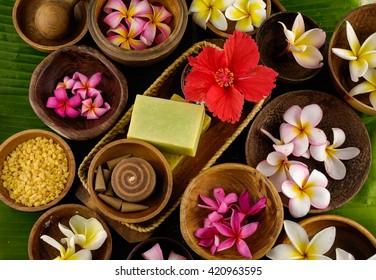 spa setting and banana leaf  - Shutterstock ID 420963595