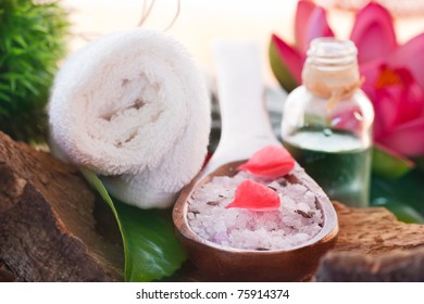 Spa setting with bath salt and towel.