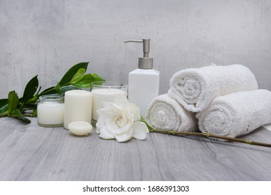 spa setting and Spa composition with white gardenia flower on wooden background