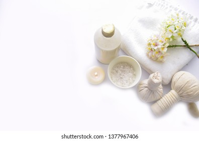 spa setting concept with, lying on orchid, herbal ball,,  ,candle,oil bottle ,salt in bowl