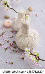 spa setting concept with, lying on cherry, herbal ball,,stones,  ,candl,petals