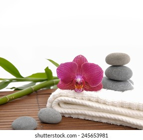 Spa setting on mat with green bamboo