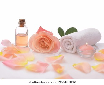 Spa setting  with rose, petals, towel, candle, oil