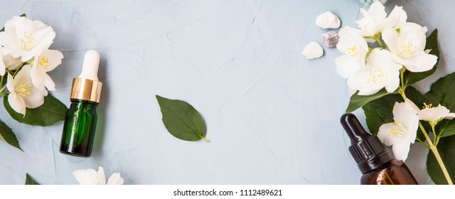 Spa setting still life top view with oil bottles and jasmine flowers