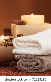 Spa setting with towels and candle