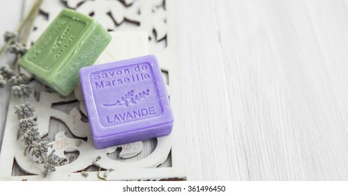 Spa setting with towels,bath salt and marseilles jasmin and olive soaps,dried lavender