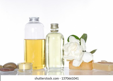 Spa setting with white gardenia and stones,oil bottle, soap,candle