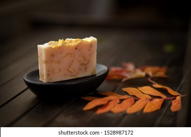 SPA Soap bar, natural organic concept, handmade soap against autumn orange and red  leaves , close up, side view