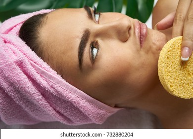 spa, sponge for face care, woman