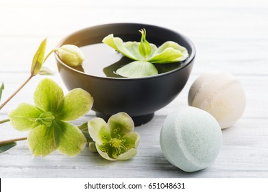 SPA still life, bath bombs on white wooden background