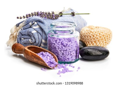 Spa still life with black stone and lavender salt isolated on white background.