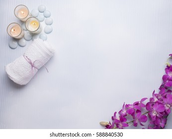 Spa still life concept,Close up of spa theme on white wood background with burning candle and orchid