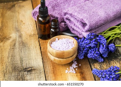 Spa still life with essence bottle, bath salt and towels