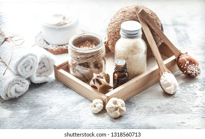 Spa still life with fresh coconut and body care products on light background, spa therapy concept