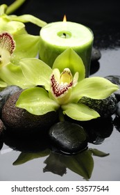Spa still life and green orchid flower and candle