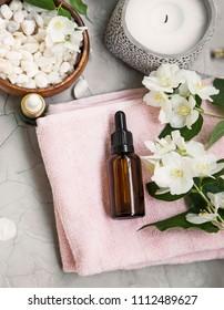 Spa still life with jasmin oil, flowers , bath salt and towels. Wellness and spa flatlay setting
