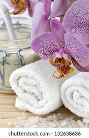 Spa still life with orchid, towel, cream, salt