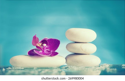 Spa still life with pink orchid and white zen stone - retro styled photo