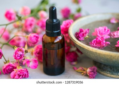 Spa still life with rose oil and floral rose water beauty treatment, spa and wellness concept