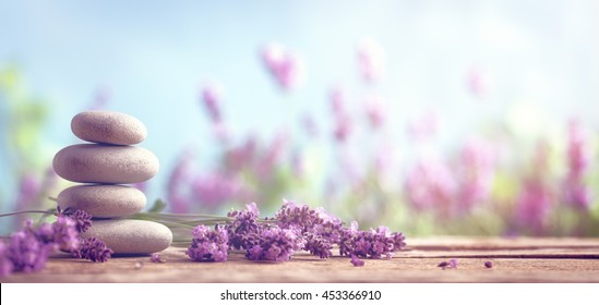 Spa still life with stack of stones and lavenders - Shutterstock ID 453366910