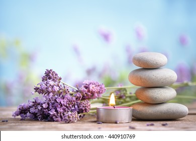 Spa still life with stack of stones,burning candles and lavenders