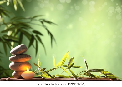 Spa still life with stacked of stone and bamboo leaf