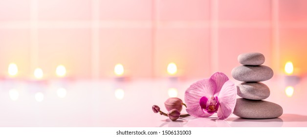 Spa still life with spa stones,burning candles and orchid.