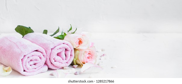 Spa still life with towels and flowers, spa and wellness setting, clean composition