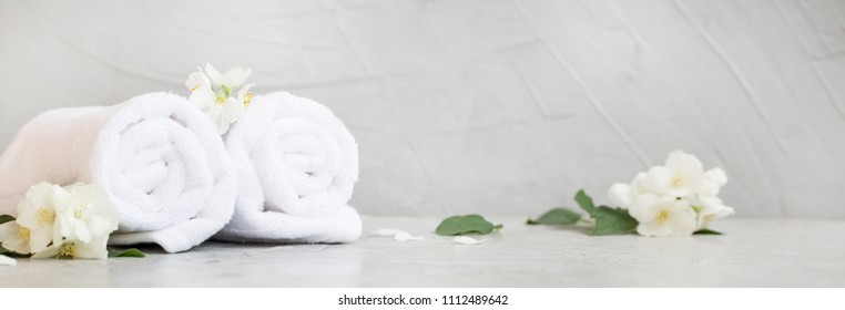 Spa still life with towels and jasmine flowers