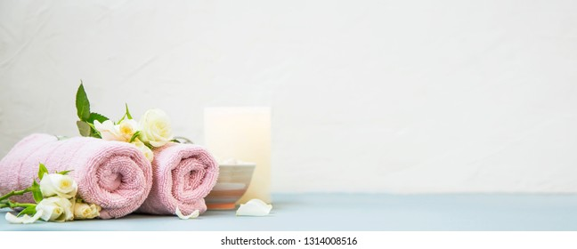 Spa still life with towels,rose flowers, bath salt and candle setting, wellness and spa still life composition