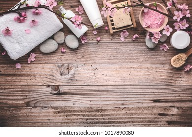 Spa still life with towel,zen stones with plum flower on vintage wooden table