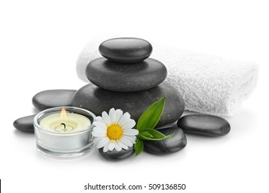 spa still life with zen basalt stones ,daisy and bamboo with candle on the white