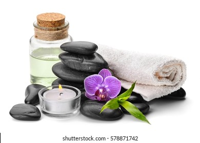 spa still life with zen basalt stones ,orchid and bamboo with candle on the white