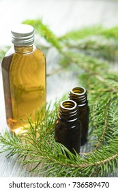 SPA still-life of essential oils and pine branch.