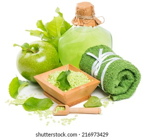 spa still-life with green apple, sea salt and moisturizer isolated on white