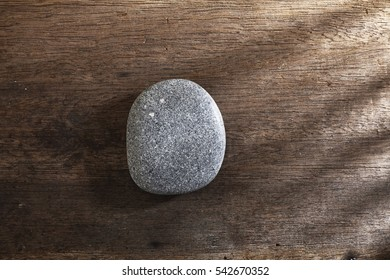 spa stone or pebble on the wooden background