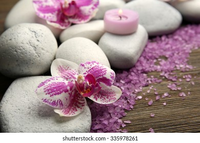 Spa stones with candles and salt closeup