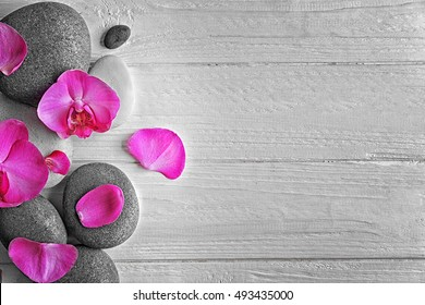 Spa stones with orchid flowers, top view