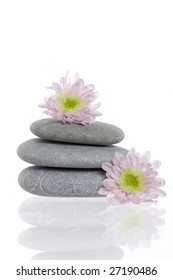 Spa stones and pink daisy on isolated white