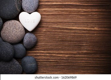 Spa stones in te wooden background.