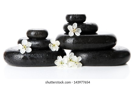 Spa stones and white flowers isolated on white