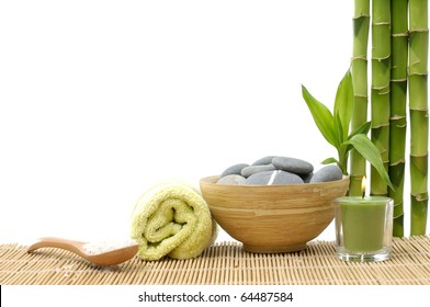 Spa style Towel with Bamboo, bowl of Massage Stones and candle