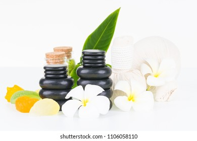 Spa therapy with hot stones, herbal compress balls, soaps and bath salts